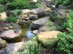 How to build a stream to look natural. This is a stream we built with a rubber liner, concrete and natural rock and boulders. Backyard Stream, Backyard Water Feature, Ponds Backyard, Backyard Landscaping, Small Garden Stream Ideas, Backyard Waterfalls, Garden Ponds, Koi Ponds, Landscaping Ideas