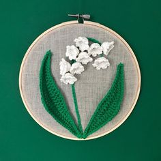 Spring is almost here! 🌿🌼🌸🌷🌱 To celebrate I made a little piece of wall art of one of my favourite spring flowers, the lily of the valley! Now I need your help because I don't know where to hang it: Green wall, yellow wall, or white wall? Swipe to see the other options and let me know with which background it looks best on. 🌷 I also recorded a free video tutorial of how I made it, accompanied by a written pattern, so you can make your own! 🌼 This would make a lovely gift for Mother's…