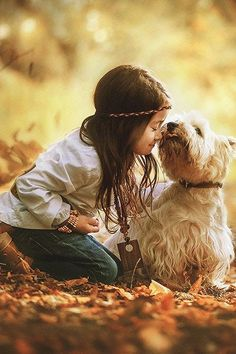 Little girl gets a loving kiss from her doggie