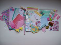 A surprise goody bag filled with  samples for planners, smash books, scrapbooking & pen pals. Etsy asprinkleoflovely