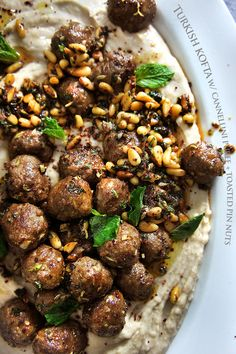 Turkish kofta (meatballs) with cannellini and yogurt puree, and toasted pine nuts