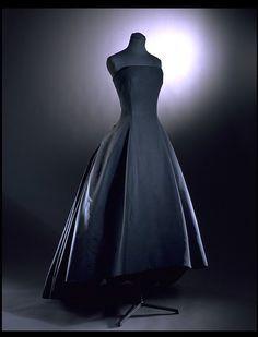 """Christian Dior, """"Soiree de Decembre"""", Y-Line Evening Gown of Boned Silk Faille. Paris, 1955-56."""
