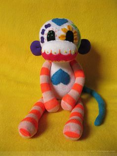 Love this Sock Monkey!; Looks as if he dressed in the dark! Cute. kn