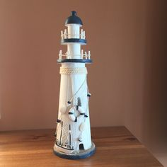This handcrafted 15 tall light house spares no detail! Meticulously designed and built giving you a nautical decor piece that you will cherish forever. As a centerpiece, this lighthouse will bring conversation to all your guests. Let this lighthouse greet your friends, family, and guests with a warm welcome and show your affinity for the nautical seafaring lifestyle.  - Handcrafted from solid wood  - Excellent handpainted rustic light house decoration  - Perfect for home decorating…