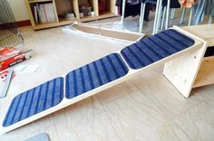 Dog ramp Ikeahack - IKEA Hackers. Would love to try this for my corgi. Maybe I could divide the ramp into three sections with hinges, allowing it to be folded away when not in use.
