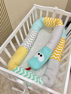 Overview Handmade item Made to order Ships worldwide from Ukraine ❤ SLEEP WELL and FEEL SECURE with our adorable handmade SNAKE CRIB BUMPER! ❤ The crib bumper in the shape of Snake/Dragon ensures a cosy and soft environment for your baby and creates a good mood for the whole family!  It can also be used for fun and playing, being a cute and kind Creature to make friends with, or simply a large, long pillow to take some rest. ITEM DETAILS: Age: 0+ months old Size: from 70 cm up to 340 ...