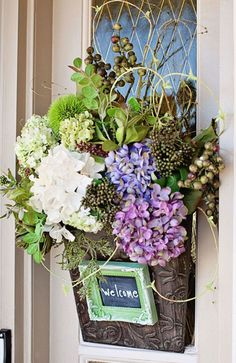Fill a metal basket with flowers (try different colors and types based on the current season), and then attach a small chalkboard to write out a welcome message to visitors. Pretty, right? Click through for more on this and other front door decor ideas. Front Door Decor, Wreaths For Front Door, Door Wreaths, Front Doors, Front Entry, Entry Doors, Deco Floral, Floral Design, Floral Wall