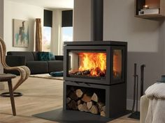 DRU – Vidar Triple is a freestanding wood stove with windows on 3 sides – Freestanding fireplace wood burning