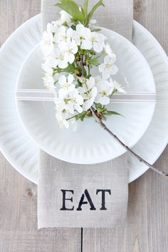beautiful white table setting....picture this with white paper plates to chic up a back yard party