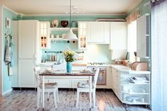 Vintage kitchen. Mint green and white home decor. Gold details.