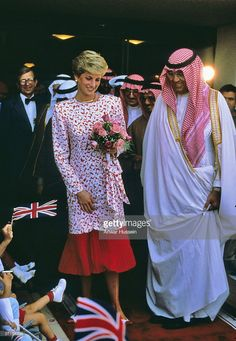 Princess Diana the Princess of Wales smiles at children waving Union Jack flags during a visit to Riyadh in Saudi Arabia in November of 1986.