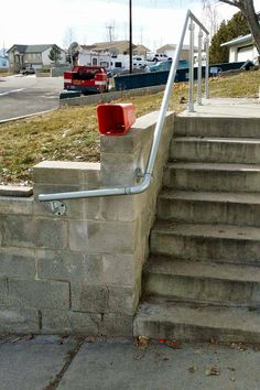 Browse this list of 13 outdoor stair rail ideas that you can build yourself using one of our railing kits. There is no cutting or welding required. Exterior Stair Railing, Black Stair Railing, Pipe Railing, Outdoor Stair Railing, Wrought Iron Stair Railing, Stairway Railing Ideas, Staircase Handrail, Bannister Ideas, Handrail Ideas