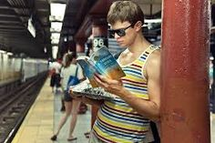 Time for our daily feature: Reading in the… subway.      Where do you read yours?    Stay tuned for more daily features of people reading in strange places and on strange things.