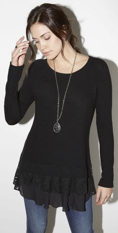 A simple pullover sweater gets a flirty update with a frilly tiered hem of sheer ruffles and lace.