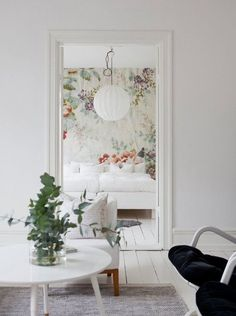 I love that white walls and floors! I'd use more colorful accent pieces via art, though