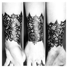 Black lace tattoo by Autumn Burns