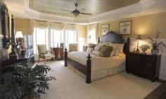 The master bedroom of William and Freddi Vaughn of Pikesville features plush bedding and a relaxing decor.