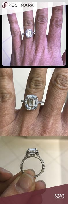 Beautiful princess cut cz ring Princess cut cz ring with surrounding stones, can't remember size but fits me like a 6 Jewelry Rings