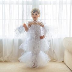 Holy DIY... The best Met Gala gowns over the years recreated on this amazing little girl who helps make them. (Alexander McQueen never looked so cute.)