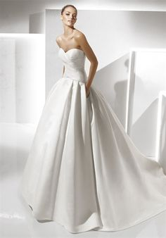 dream dress right here. La Sposa Salsa....get it at the Gown gallery and bridal loft in KC.