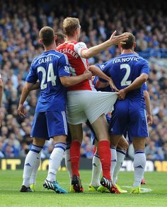 Mertesacker has his shorts tugged by Ivanovic during a corner at Stamford Bridge in October - and fellow Chelsea defender Gary Cahill (left) grabs hold of the German's torso for good measure Arsenal Fc, Gary Cahill, Stamford Bridge, It's Going Down, Football Kits, Chelsea Fc, Rogues, The Darkest, Soccer