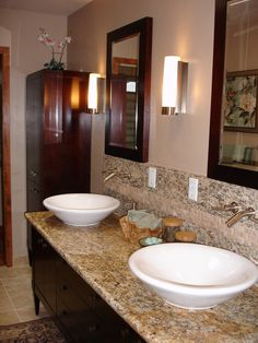 Vessel sinks, wall mounted faucets and granite make this a showy vanity.