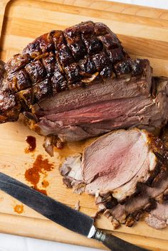 Serve a crowd with this easy roast leg of lamb rubbed with garlic, lemon juice and oregano then roasted until golden brown on the outside and pink on the inside.