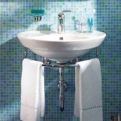 Replacing a vanity with a wall-hung sink is one of the best ways to make a small bathroom feel roomier.