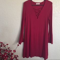 Criss Cross Knit Dress Burgundy Criss Cross Detailed Solid Knit Dress. 95% Rayon 5% Spandex Double Lined underneath. Bell Long Sleeve Arms. Made in the U.S.A. Brand New.  Sizes Small, Medium, and Large Available.   Price is firm unless bundled.  ~Please don't purchase this listing. I will create a new one for you with your size~ Boutique Dresses Mini