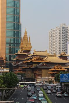 Jing'an Temple, Shanghai roofs of pure gold and a body of wood..It sits amongst the sky scrapers of this megalopolis like a reminder of its past like a warning to not forget the old as the new arises from its ashes