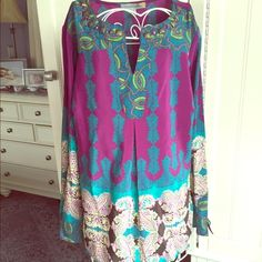 Jewel tone tribal tunic This gorgeous silky tunic has the most amazing design and colors. Green, blue, yellow, purple, aqua, white, turquoise. Beautiful metallic stud detail at neckline. Gently worn in excellent condition with no flaws. Would fit medium or large. Figuero & Flowers Tops Tunics