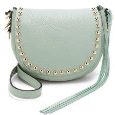 A rounded Rebecca Minkoff cross-body bag in full-grain leather. Polished studs accent the magnetic top flap, which covers a slim front pocket and an unlined in…