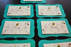 Peacock Place Cards by TheSouthernSoiree on Etsy, $12.00 surrounded by blue green purple petals