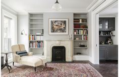 Parlor with restored mantel and antique Lisa Sherman chaise in Brooklyn renovation by Elizabeth Roberts.