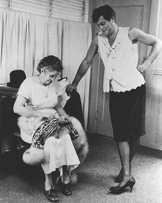 """it takes a real man to wear a dress - tony curtis getting a fitting during """"some like it hot"""" I'm guessing"""