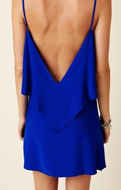 "If you are wearing a low back dress like this, try wearing a Lariat style necklace backwards.  The ""tail"" of the necklace would hang down your back elongating it."