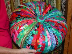 "Tuffet by Sharyn Floriani Cole made with Kaffe Fassett Collective fabrics. 6"" X 18"" round upholstery foam trimmed and rounded on the shoulders. Heavy Upholstery Batting attached firmly to round out the shape"