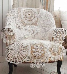 It looks as if lots of lacy doilies were sewn together to make this wonderful throw.