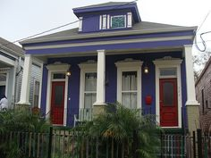 New Orleans pretty painted house with Mardi Gras beads