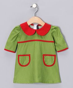 This darling dress is made of soft, comfy cotton. With its charming Peter Pan collar and quirky front pockets, it offers a stylish take on a classic schoolgirl silhouette.100% cottonMachine wash; tumble dryMade in the USA