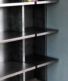 Detail of bookcase with liquid metal finish.