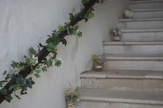 Farnham Castle | Stone Stairs Entrance Styling | Ivy Garland | Flowers designed and created for Farnham Castle Weddings and Events located in Farnham, Surrey by Hannah Berry Flowers  www.hannahberryflowers.co.uk | Photo by http://www.ljphoto.co.uk/