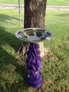 This was a very ugly lamp (was sand looking) I painted purple and topped with this basin I found at the thrift store upcycled to this, I call The Grapes of Wrath birdbath!