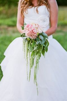 Cascade bouquet featuring lots of foliage and pink dahlias.