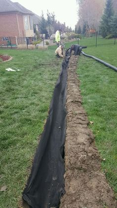 The picture provided shows a French Drain trench being lined with an 8 oz. commercial grade filter fabric that is rated for 90 GPM through 1 Sq. Ft. of fabric. This allows for fast drainage of surface and ground water during even the heaviest rain events. The heavy 8 oz. fabric will not decompose allowing sediment to plug the saw cut corrugated pipe. All the stone around the pipe is wrapped with this fabric, making it impossible for contamination to enter into the French Drain.