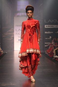 Brick red kalamkari long short brasso kurta with kalamkari patchwork churidar.