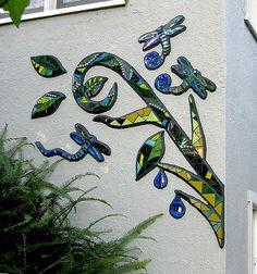 """Whimsical mosaic mural using pieces left over from a previous job. 62"""" x 62"""""""