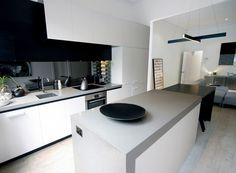 A mid-grey shade with darker toned quartz chips blended to create a natural looking surface, Oyster™ 4030 from the Caesarstone Standard Range. Kitchen Living, New Kitchen, Kitchen Cupboard, Kitchen Interior, Kitchen Decor, Kitchen Ideas, Kitchen Benchtops, Kitchen Colour Schemes, Best Kitchen Designs