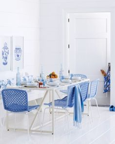 Breakfast Blue - Traditional porcelain with a Chinese motif provides a charming reference point for this crisp breakfast room. The mesh weave on the light, modern chairs, which are painted in two shades of blue (in an easy-to-clean acrylic semigloss) echoes and updates the fishnet-pattern rims on the china. On the vintage bench, a cushion upholstered in a graceful floral is coated in Tyvek for effortless wipe-downs.