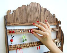 Jewelry Organizer Storage / Wall Mount Display Holder, 84 PAIRS of EARRINGS, 15 Pegs for Necklaces Bracelets and Rings. $97.95, via Etsy.